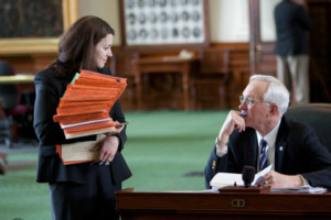 Picture of Texas Senate Parliamentarian talking with Senator