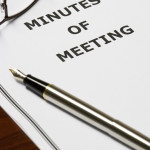 meeting minutes with pen