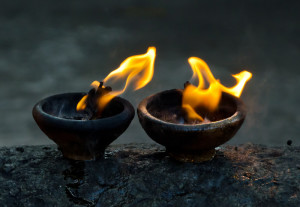 Photo of 2 flickering oil lamps