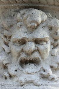 carving of angry bully