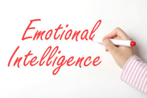 words emotional intelligence written on whiteboard