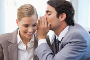 photo of whispering and sidebar conversations